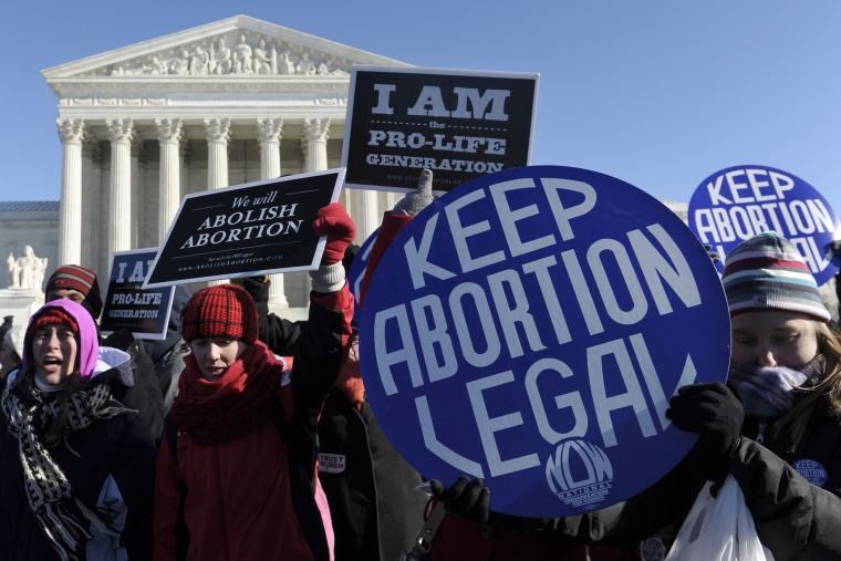 Pro-abortion and anti-abortion protestors rally outside the Supreme Court in Washington, D.C., Jan. 22, 2014.
