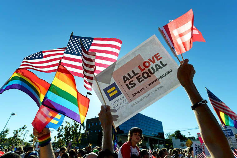 Same-sex marriage supporters celebrate the US Supreme Court ruling during a community rally on June 26, 2013