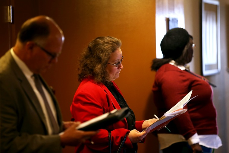Job seekers fill out applications before the start of the HireLive career fair on June 4, 2014 in San Francisco, California.