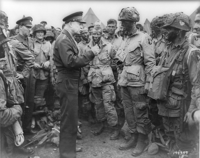 Allied forces Supreme Commander General Dwight D. Eisenhower speaks with U.S. Army paratroopers of Easy Company, 502nd Parachute Infantry Regiment (Strike) of the 101st Airborne Division, at Greenham Common Airfield in England June 5, 1944.