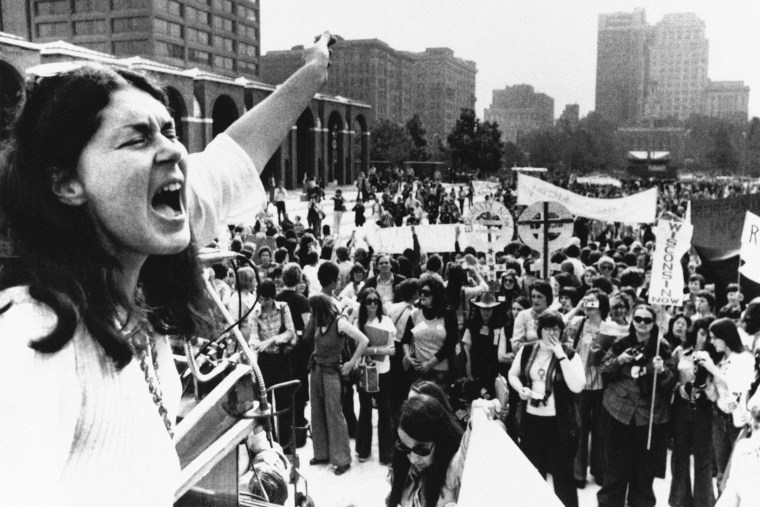 Karen DeCrow, president of the National Organization for Women, shouts to a crowd during a NOW parade held in Philadelphia, Oct. 25, 1975.