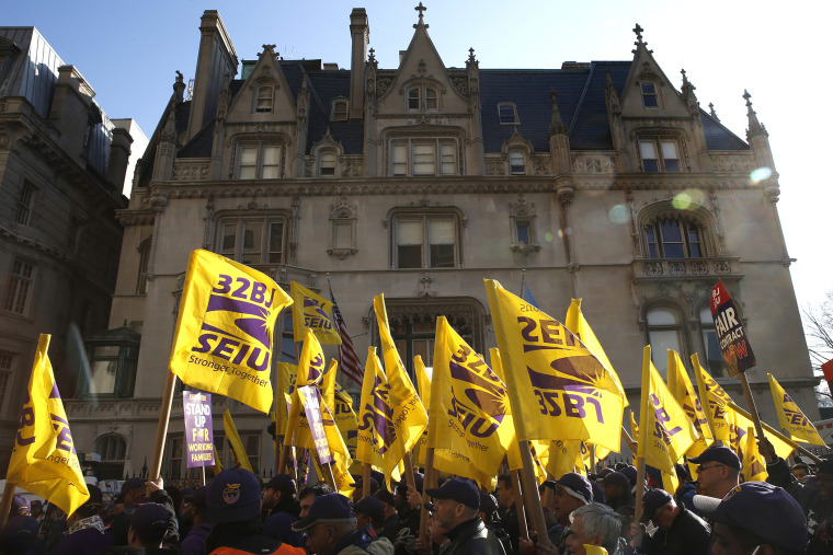 Members of the Service Employees International Union (SEIU) march during a protest in support of a new contract for apartment building workers in New York City, April 2, 2014
