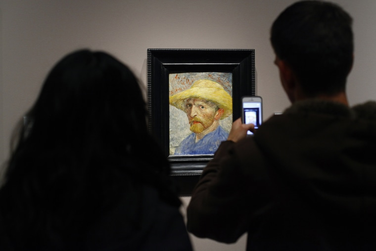 "A couple looks at a painting titled ""Self Portrait"" by artist Vincent van Gogh displayed at the Detroit Institute of Arts in Detroit, Mich. on Dec. 7, 2013."
