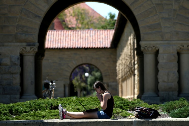 A woman works on a laptop on the Stanford University campus on May 22, 2014 in Stanford, California.