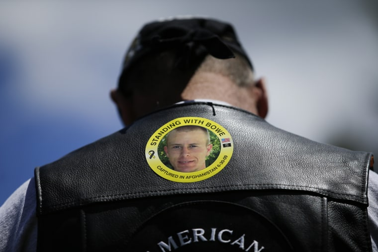 """In this Saturday, June 22, 2013 file photo, Gulf War veteran Ron Coumerilh wears a sticker to support captive U.S. Army Sgt. Bowe Bergdahl at the """"Bring Bowe Back"""" celebration in Hailey, Idaho."""