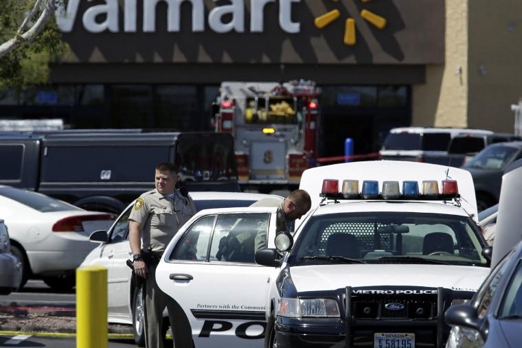 Las Vegas Metropolitan Police Department officers are at the scene of a shooting on June 8, 2014 in Las Vegas.