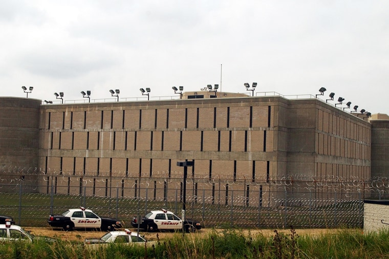 Sheriff's department cars are parked near the Suffolk County Correctional Facility in Riverhead, N.Y.