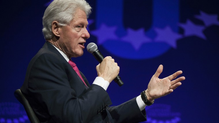 """Former U.S. President Bill Clinton begins a discussion for the opening plenary session titled \""""The Age of Participation\"""" on the first day of the 2014 Meeting of the Clinton Global Initiative University at Arizona State University in Tempe, Arizona, March"""
