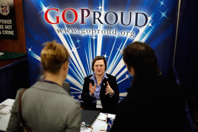 Participants talk with a representatives from GOProud, an organization that represents gay conservatives and their allies, at a Conservative Political Action Conference.