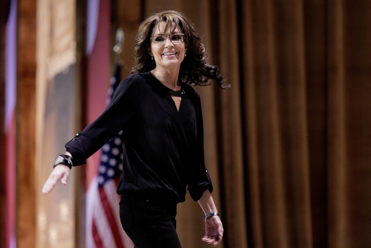 Sarah Palin waves as she leaves the stage during the 41st annual Conservative Political Action Conference on March 8, 2014 in National Harbor, Maryland.