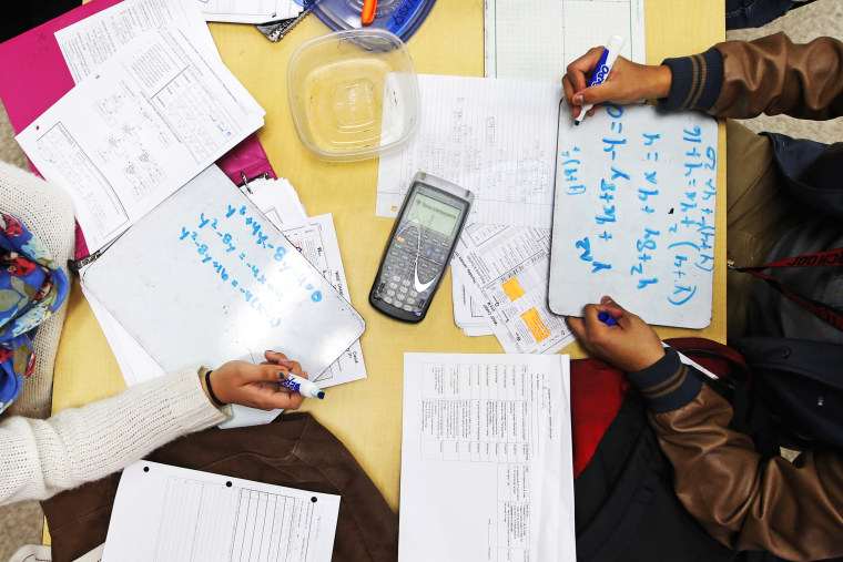Students solve problems in a pre-calculus class at Segerstrom High School in Santa Ana, Calif., Jan. 16, 2013.