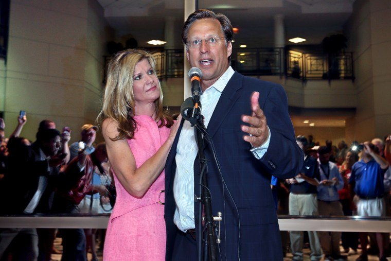 Dave Brat, stands his wife, Laura, as he speaks to supporters after defeating Republican Congressman Eric Cantor in the Republican primary for the 7th Congressional District in Virginia,  June 10, 2014.