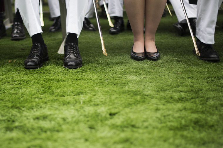 A female cadet sits among male cadets during a commencement ceremony in West Point, New York, May 28, 2014.