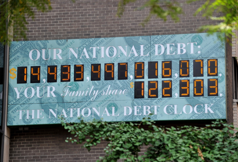 The National Debt Clock, a billboard-size digital display showing the increasing US debt, on Sixth Avenue August 1, 2011 in New York.