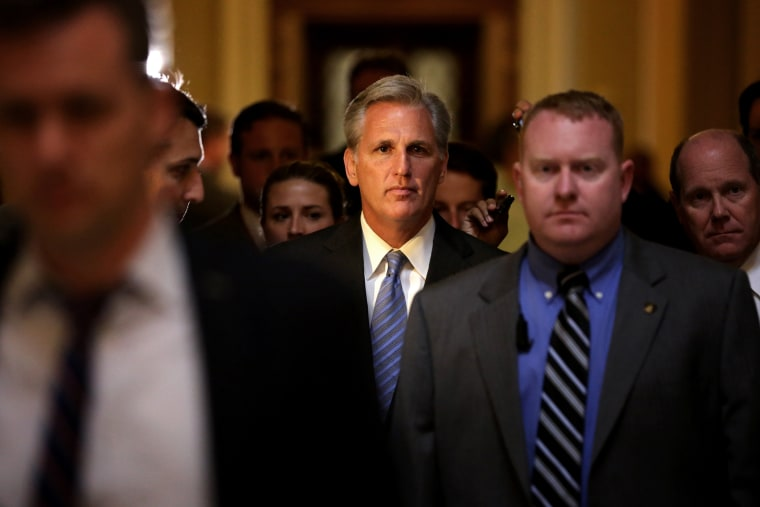 U.S. House Majority Whip Rep. Kevin McCarthy (R-CA) (C) passes through the Statuary Hall of the Capitol after a vote on the House floor June 11, 2014 on Capitol Hill in Washington, DC.