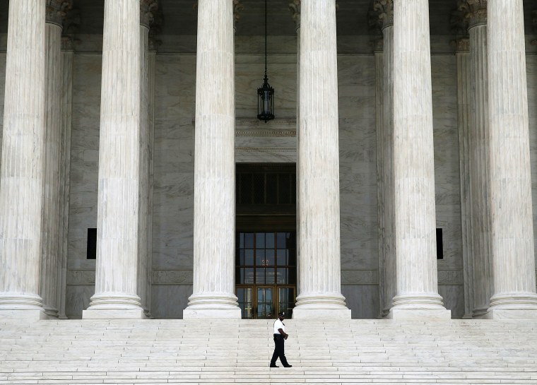 A guard stands outside the U.S. Supreme Court , on June 9, 2014 in Washington, DC.