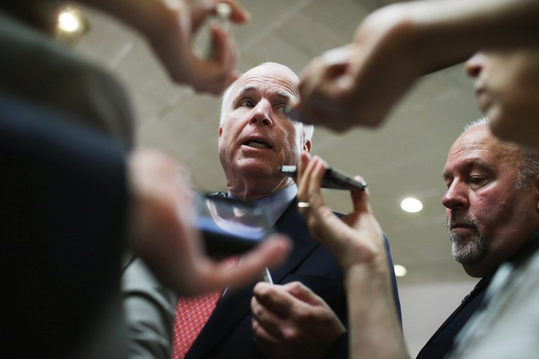 Senate Armed Services Committee Member U.S. Sen. John McCain (R-AZ) talks with reporters at the U.S. Capitol, June 10, 2014.