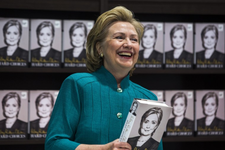 Hillary Clinton prepares to sign copies of her new memoir 'Hard Choices' at a Costco store in Arlington, Va, June 14, 2014.