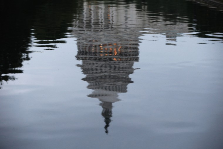 The U.S. Capitol is reflected in water on the morning of June 11, 2014 in Washington, DC.