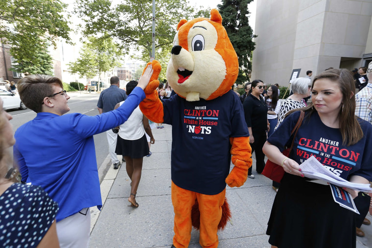 "A Republican intern in a squirrel costume and a T-shirt that reads, ""Another Clinton in the White House is Nuts"""