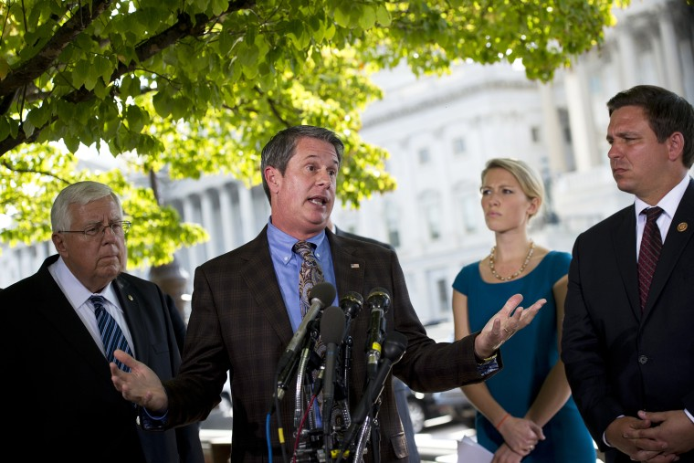 US Senator David Vitter (C) speaks during a press conference on Capitol Hill, September 30, 2013.