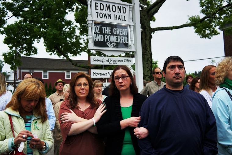 People attend a remembrance event on the six month anniversary of the massacre at Sandy Hook Elementary School on June 14, 2013 in Newtown, Connecticut.
