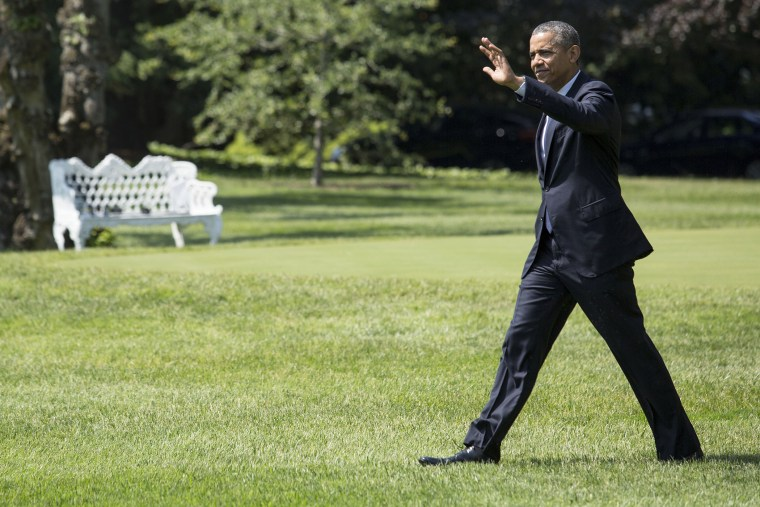 U.S. President Barack Obama walks toward Marine One on the South Lawn of the White House, on June 17, 2014.