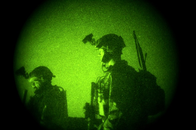 U.S. Special Operations Forces are seen through a night vision scope during a joint operation with Afghan National Army soldiers targeting insurgents in Afghanistan's Farah province on Oct. 29, 2009.