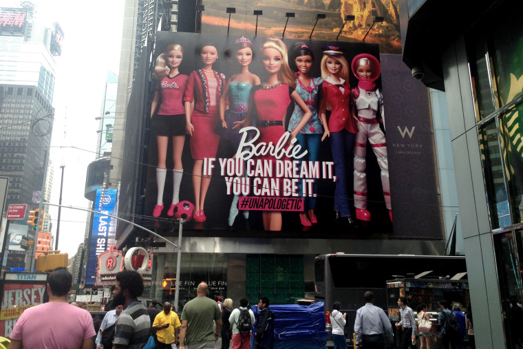 "A billboard featuring a new ""Entrepreneur Barbie"" doll in Times Square, New York City on June 19, 2014."