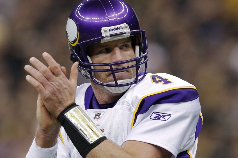 Minnesota Vikings quarterback Brett Favre celebrates his touchdown against the New Orleans Saints during the first quarter of the NFL's NFC Championship football game in New Orleans, Louisiana, Ja. 24, 2010.