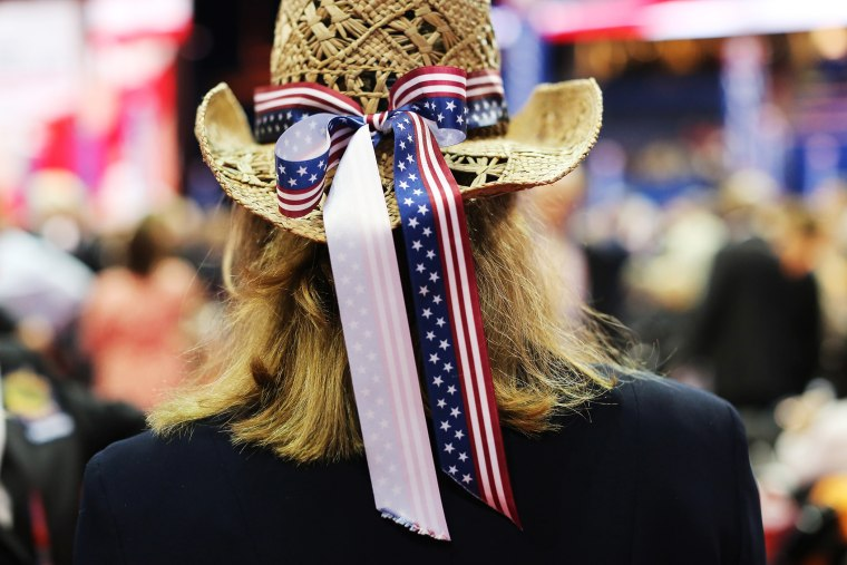 A woman wears a cowboy hat with a patriotic bow during the final day of the Republican National Convention, Aug. 30, 2012 in Tampa, Fla.
