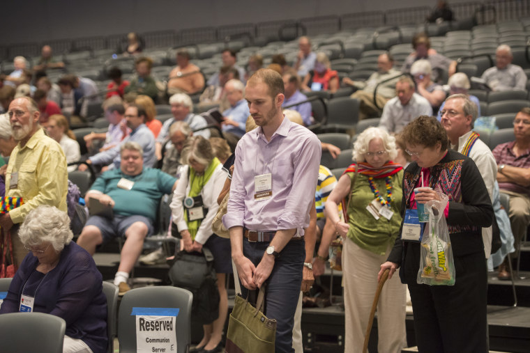 The audience takes part in an opening prayer at the 221st General Assembly of the Presbyterian Church at Cobo Hall, in Detroit, on June 19, 2014