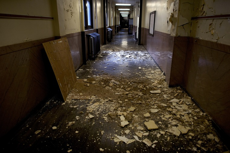Debris litters the now vacant hallways of the George W. Childs School in Philadelphia, Jan. 31, 2014.