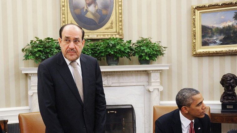 Iraqi Prime Minister Nouri Al-Maliki (L) looks on after a meeting U.S. President Barack Obama in the Oval Office at the White House November 1, 2013 in Washington, DC.