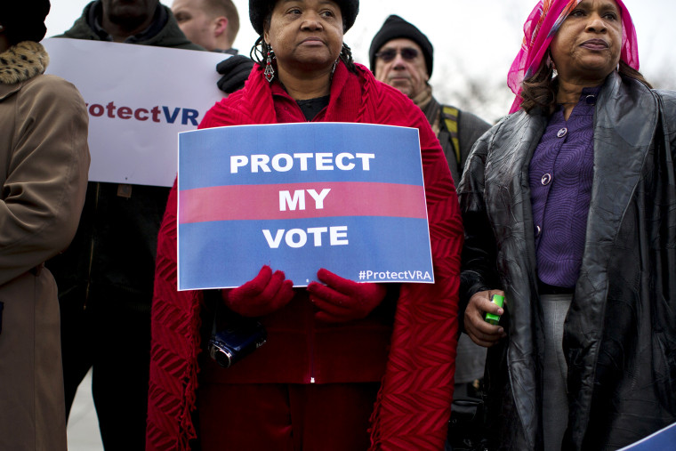 People wait in line outside the Supreme Court in Washington, Wednesday, Feb. 27, 2013, to listen to oral arguments in the Shelby County, Ala., v. Holder voting rights case.