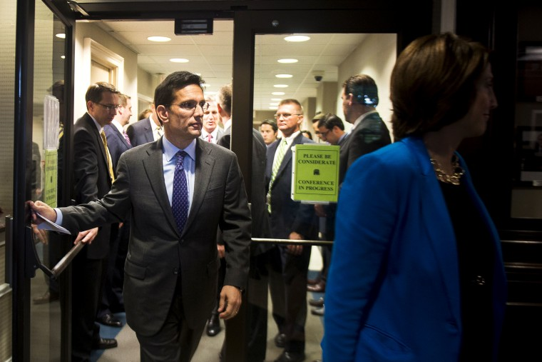 Eric Cantor enters a news conference at the Republican National Committee headquarters in Washington, Oct. 23, 2013.