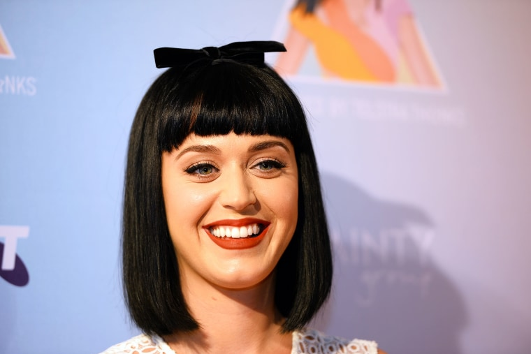 Katy Perry poses for photos at the launch of her Prismatic world tour in Sydney, March 4, 2014.