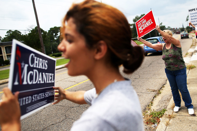 Supporters of Republican candidate for U.S. Senate, Mississippi State Sen. Chris McDaniel hold signs during a Tea Party Express campaign event in Biloxi, Mississippi, June 22, 2014.