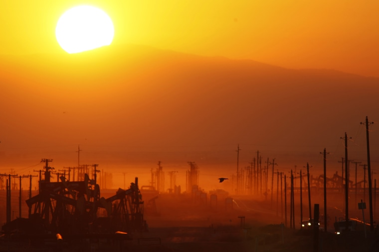 The sun rises over an oil field over the Monterey Shale formation where gas and oil extraction using hydraulic fracturing, or fracking, is on the verge of a boom on March 24, 2014 near Lost Hills, Calif.