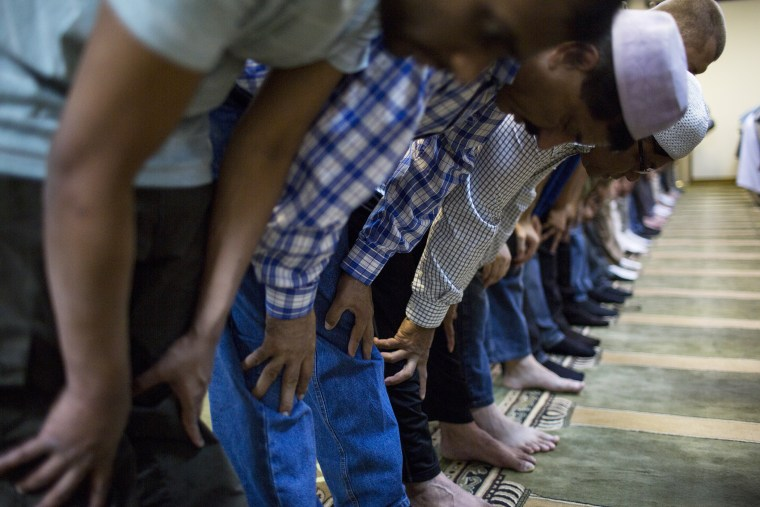 Muslim-American men attend noon-day prayers at the Dar-ul-Islah Mosque on Friday September 28, 2012 in Teaneck, New Jersey.