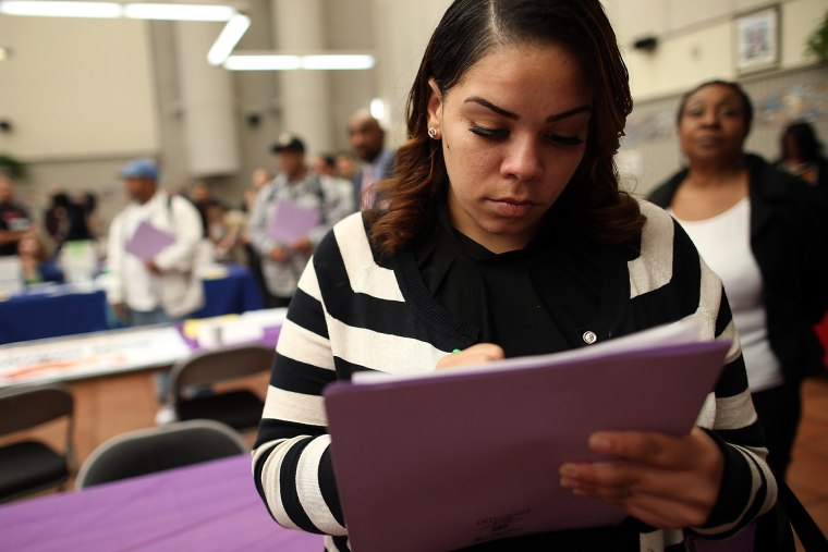 A job seeker fills out an application during a career fair at the Southeast Community Facility Commission on May 21, 2014 in San Francisco, California.