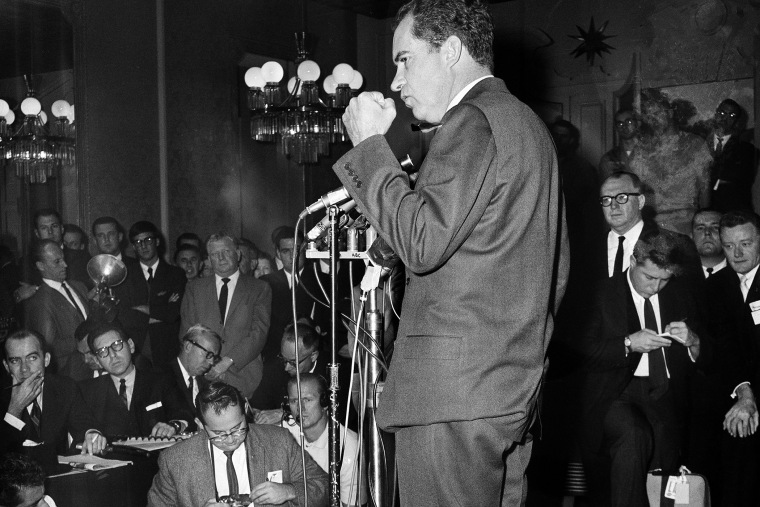 Former Vice President Richard M. Nixon shakes his fist as he made critical remarks about news coverage of his campaign for governor as he conceded defeat in the race for the California governorship on Nov. 7, 1962.