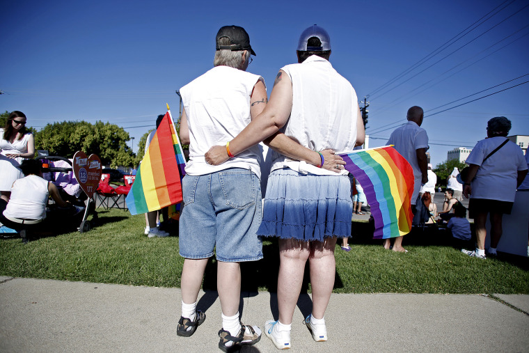 Skinner and her wife Belka wait for the beginning of the Utah Pride Parade in Salt Lake City
