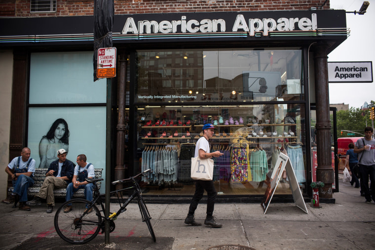 People walk past an American Apparel store on June 19, 2014 in New York City.