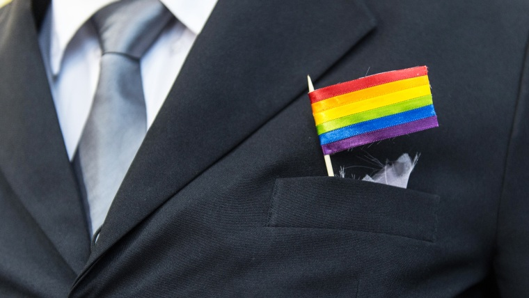 A man wears a rainbow flag in his pocket, December 8, 2013.