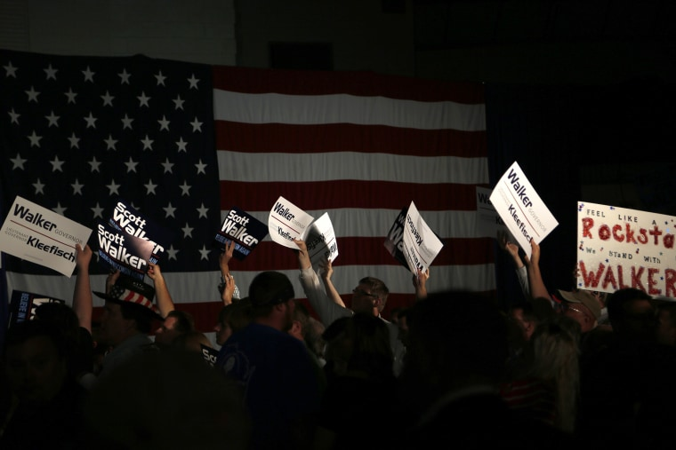 Supporters cheer during an election night rally for Republican Wisconsin Governor Walker in Waukesha