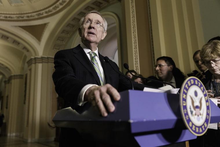 Senate Majority Leader Harry Reid of Nev. speaks to reporters on Capitol Hill in Washington, June 24, 2014.