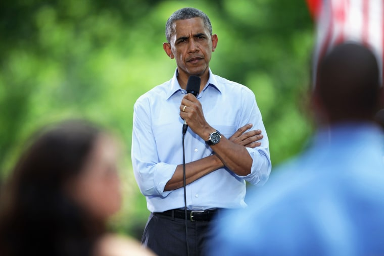 President Barack Obama listens to a speaker at an invite-only town hall meeting on Thursday, June 26, 2014, at Minnehaha Park in Minneapolis, Minn.