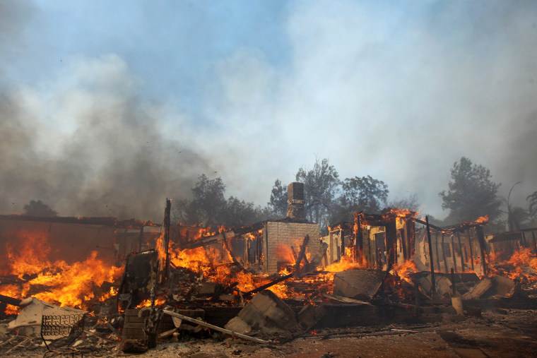 A house burns at the Cocos fire on May 15, 2014 in San Marcos, California.