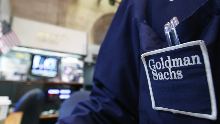 A trader works at the Goldman Sachs stall on the floor of the New York Stock Exchange, April 16, 2012.